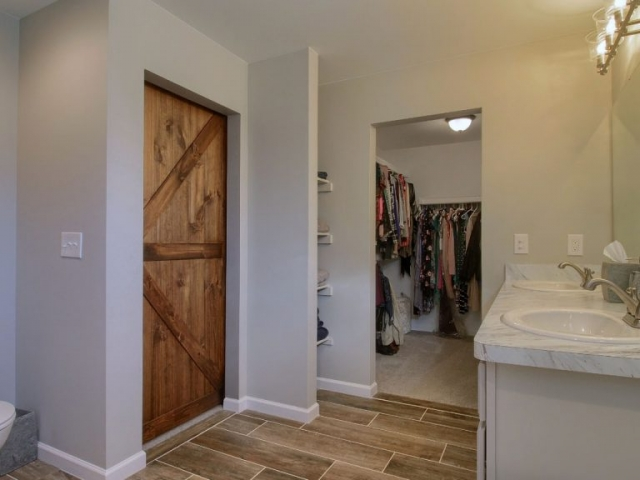 custom bathroom with closets.